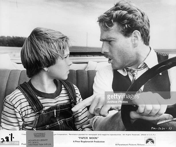 Ryan O'Neal drives while having a serious discusses with Tatum O'Neal in a scene from the film 'Paper Moon' 1973