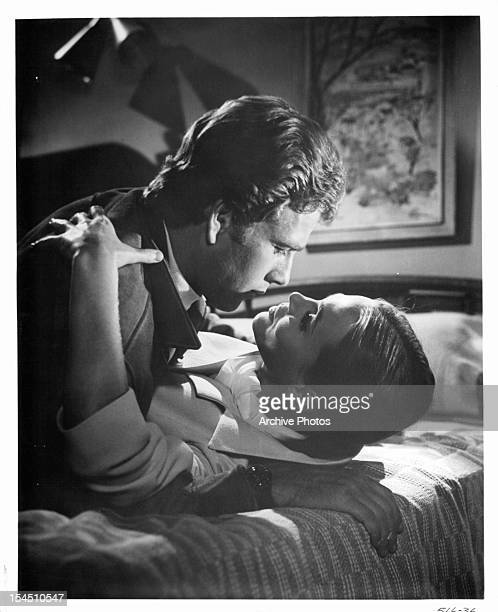 Ryan O'Neal prepares to kiss Leigh TaylorYoung in a scene from the film 'The Big Bounce' 1969