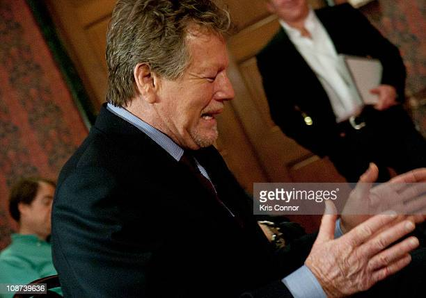 Ryan O'Neal reacts to Nels Van Patten speaking about the late Farrah Fawcett during the Farrah Fawcett Memorabilia Donation at the Smithsonian...