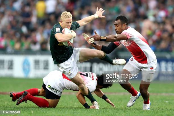 Ryan Oosthuizen of South Africa makes a break on day one of the Cathay Pacific/HSBC Hong Kong Sevens at the Hong Kong Stadium on April 05 2019 in...