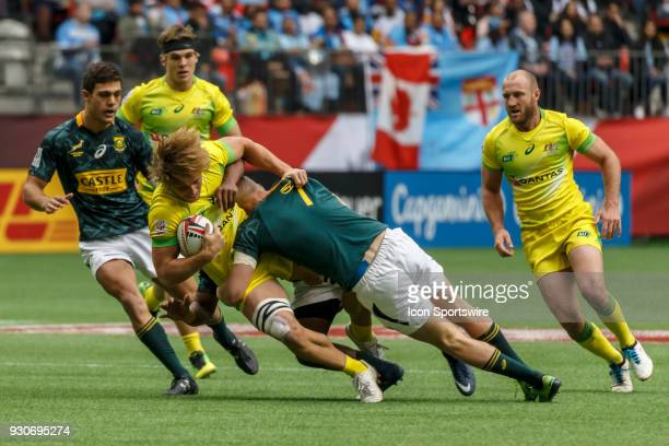 Ryan Oosthuizen of South Africa tackles Lewis Holland of Australia of South Africa during Game Australia vs South Africa Cup QF1 match at the Canada...