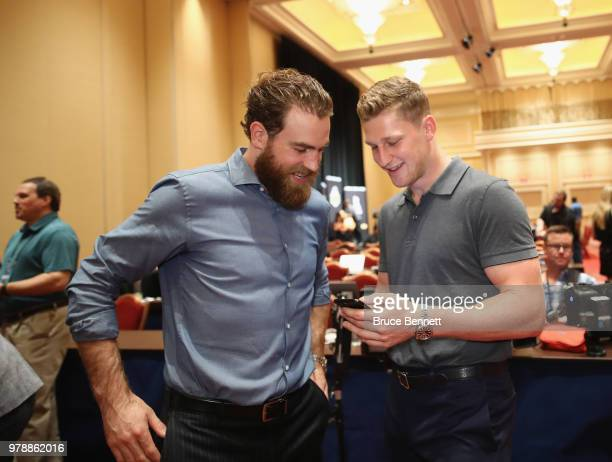 Ryan O'Reilly and Nathan MacKinnon share a laugh during the 2018 NHL Awards nominee media availability at the Encore Las Vegas on June 19 2018 in Las...