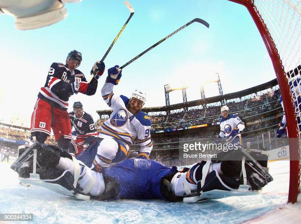 Ryan O'Reilly ands Robin Lehner of the Buffalo Sabres defend the net against Pavel Buchnevich of the New York Rangers during the 2018 Bridgestone NHL...