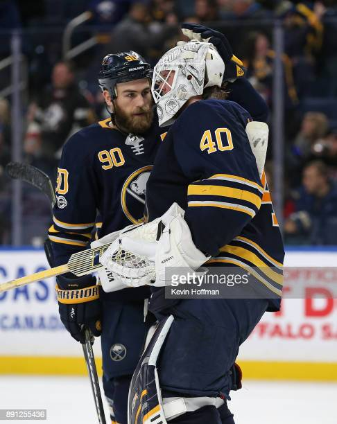 Ryan O'Reilly congratulates Robin Lehner of the Buffalo Sabres after beating the Ottawa Senators at the KeyBank Center on December 12 2017 in Buffalo...