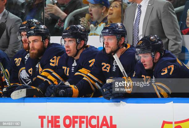 Ryan O'Reilly Evan Rodrigues Sam Reinhart and Casey Mittelstadt of the Buffalo Sabres watch the action during an NHL game against the Detroit Red...
