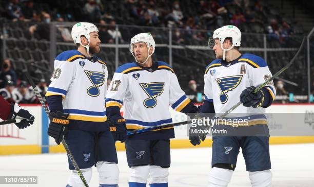 Ryan O'Reilly, Jaden Schwartz and Vladimir Tarasenko of the St Louis Blues chat during a timeout against the Colorado Avalanche at Ball Arena on...