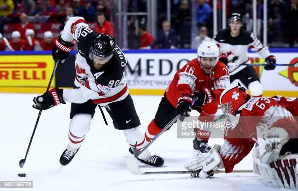 Ryan O'Reilly of Canada fails to score over Leonardo Genoni goaltender of Switzerland during the 2018 IIHF Ice Hockey World Championship Semi Final...
