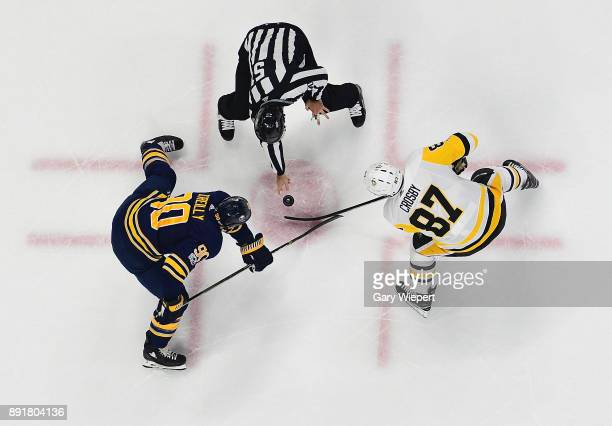 Ryan O'Reilly of the Buffalo Sabres and Sidney Crosby of the Pittsburgh Penguins take a faceoff during an NHL game on December 1 2017 at KeyBank...