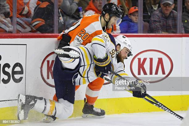 Ryan O'Reilly of the Buffalo Sabres and Taylor Leier of the Philadelphia Flyers battle for the puck during the third period at Wells Fargo Center on...