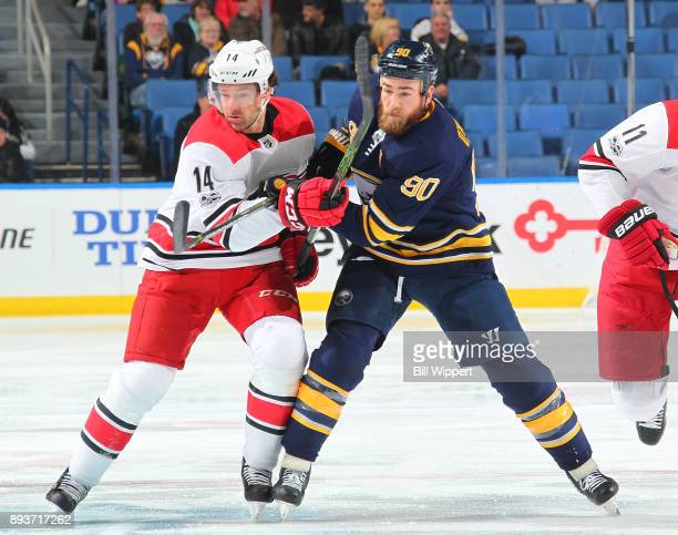 Ryan O'Reilly of the Buffalo Sabres battles for position with Justin Williams of the Carolina Hurricanes during an NHL game on December 15 2017 at...