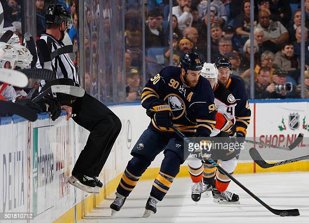 Ryan O'Reilly of the Buffalo Sabres carries the puck in front of Jiri Sekac of the Anaheim Ducks at First Niagara Center on December 17 2015 in...