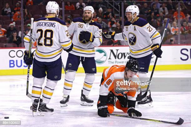 Ryan O'Reilly of the Buffalo Sabres celebrates his goal against the Philadelphia Flyers with teammates during the first period at Wells Fargo Center...