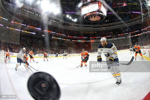 Ryan O'Reilly of the Buffalo Sabres chases down a loose puck against the Philadelphia Flyers during the first period at Wells Fargo Center on...