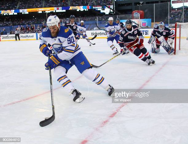 Ryan O'Reilly of the Buffalo Sabres controls the puck against the New York Rangers during the 2018 Bridgestone NHL Winter Classic at Citi Field on...