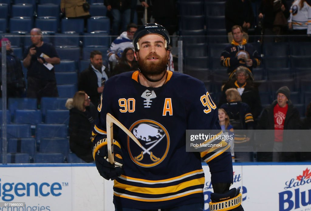 Ryan O'Reilly #90 of the Buffalo Sabres looks for a fan to give a souvenir stick to following their 5-3 victory against the Tampa Bay Lightning in an NHL game on February 13, 2018 at KeyBank Center in Buffalo, New York.