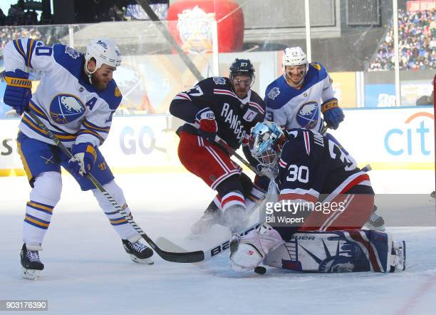 Ryan O'Reilly of the Buffalo Sabres looks for the puck against Henrik Lundqvist of the New York Rangersduring the 2018 Bridgestone NHL Winter Classic...