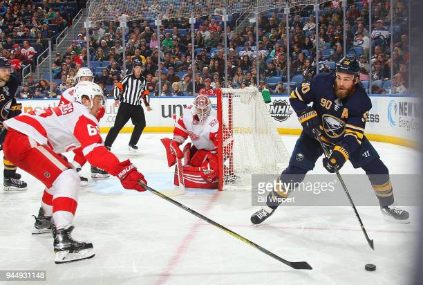 Ryan O'Reilly of the Buffalo Sabres passes the puck during an NHL game against Danny DeKeyser of the Detroit Red Wings on March 29 2018 at KeyBank...