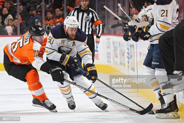 Ryan O'Reilly of the Buffalo Sabres skates past Jori Lehtera of the Philadelphia Flyers during the first period at Wells Fargo Center on January 7...