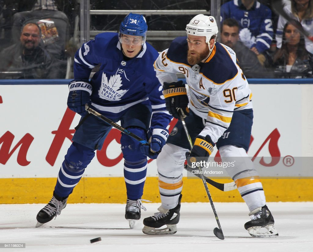 Ryan O'Reilly #90 of the Buffalo Sabres skates with the puck against Auston Matthews #34 of the Toronto Maple Leafs during an NHL game at the Air Canada Centre on April 2, 2018 in Toronto, Ontario, Canada. The Maple Leafs defeated the Sabres 5-2.