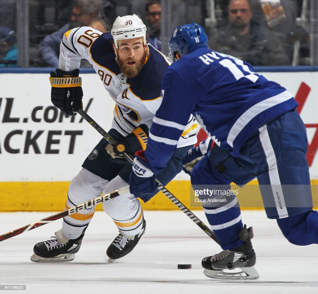 Ryan O'Reilly #90 of the Buffalo Sabres skates with the puck against Zach Hyman #11 of the Toronto Maple Leafs during an NHL game at the Air Canada Centre on April 2, 2018 in Toronto, Ontario, Canada. The Maple Leafs defeated the Sabres 5-2.
