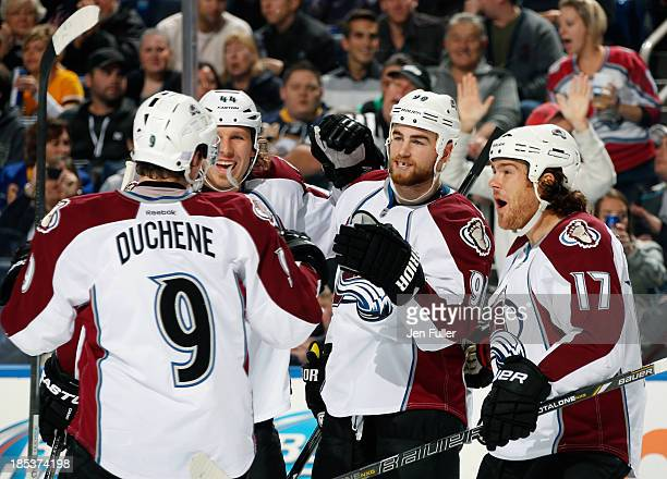 Ryan O'Reilly of the Colorado Avalanche celebrates his first period goal against the Buffalo Sabres with teammates Matt Duchene Steve Downie and Ryan...