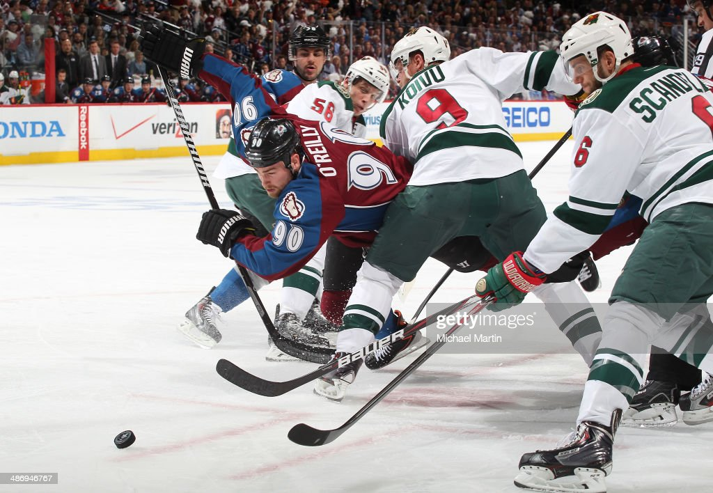Ryan O'Reilly #90 of the Colorado Avalanche plays for the puck as he is checked by Mikko Koivu #9 of the Minnesota Wild in Game Five of the First Round of the 2014 Stanley Cup Playoffs at the Pepsi Center on April 26, 2014 in Denver, Colorado.