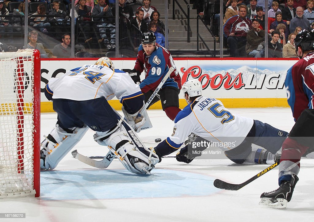 Ryan O'Reilly #90 of the Colorado Avalanche puts a shot on goal against goaltender Jake Allen #34 and Barret Jackman #5 of the St Louis Blues at the Pepsi Center on April 21, 2013 in Denver, Colorado. The Avalanche defeated the Blues 5-3.