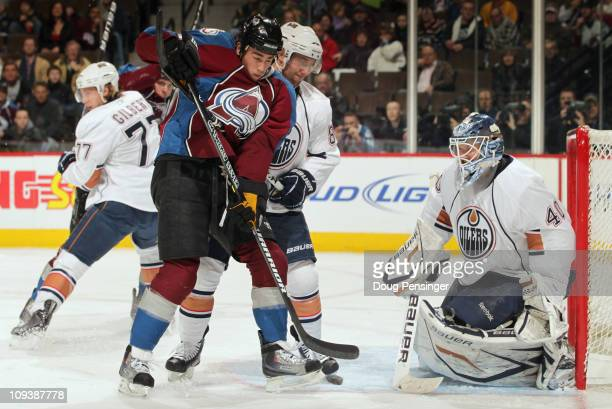 Ryan O'Reilly of the Colorado Avalanche tries to redirect the puck as Sam Gagner of the Edmonton Oilers defends and goalie Devan Dubnyk of the Oilers...