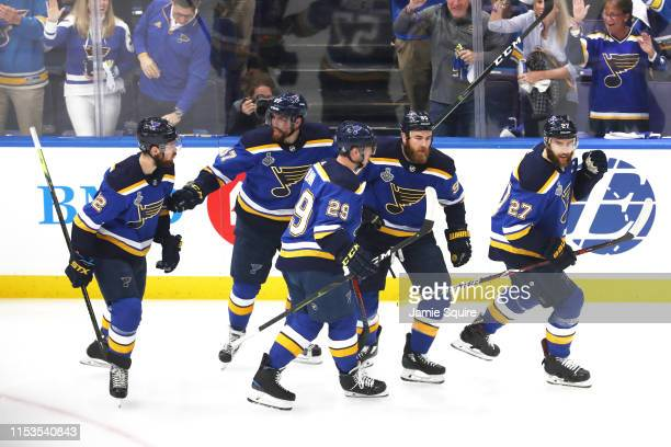 Ryan O'Reilly of the St. Louis Blues celebrates his first period goal with Alex Pietrangelo and Vince Dunn against the Boston Bruins in Game Four of...