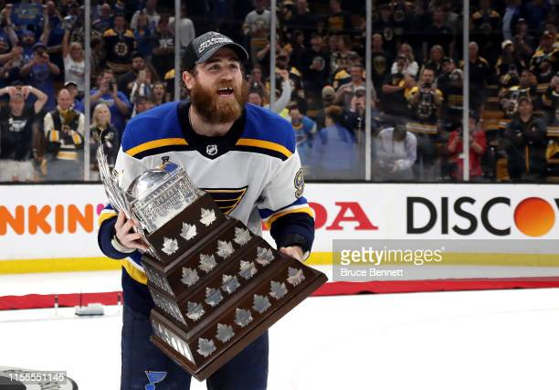 Ryan O'Reilly of the St. Louis Blues celebrates with the Conn Smythe Trophy after defeating the Boston Bruins 4-1 to win Game Seven of the 2019 NHL...