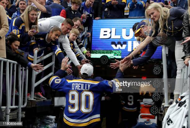 Ryan O'Reilly of the St Louis Blues highfives fans after defeating the San Jose Sharks in Game Six with a score of 5 to 1 to win the Western...