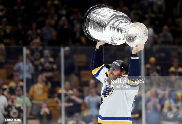 Ryan O'Reilly of the St Louis Blues hoists the cup after defeating the Boston Bruins 41 to win Game Seven of the 2019 NHL Stanley Cup Final at TD...