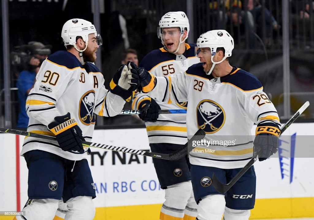 Ryan O'Reilly #90, Rasmus Ristolainen #55 and Jason Pominville #29 of the Buffalo Sabres celebrate after teammate Evander Kane (not pictured) #9 scored against the Vegas Golden Knights to tie the game at 4-4 with nine seconds left in the third period of their game at T-Mobile Arena on October 17, 2017 in Las Vegas, Nevada. The Golden Knights won 5-4 in overtime.