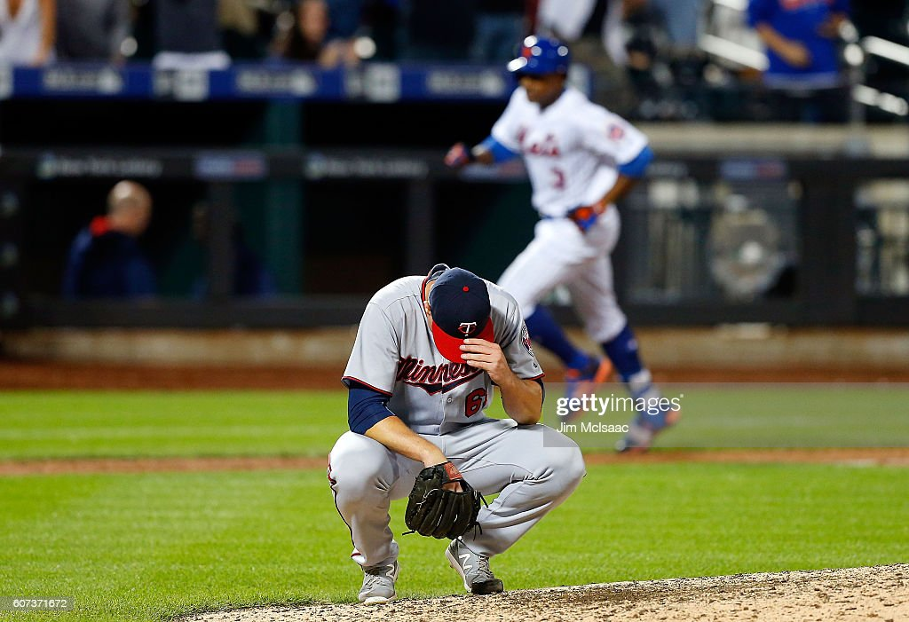 Ryan O'Rourke #61 of the Minnesota Twins reacts after surrendering a game winning twelfth inning home run against Curtis Granderson #3 of the New York Mets at Citi Field on September 17, 2016 in the Flushing neighborhood of the Queens borough of New York City.