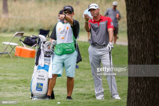 Ryan Palmer and his caddie discuss the approach shot on during the third round of the ATT Byron Nelson on May 20 2017 at the TPC Four Seasons Resort...