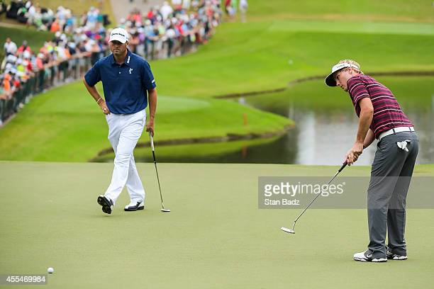 Ryan Palmer and Russell Henley finish their rounds on the 18th hole green during the final round of the TOUR Championship by CocaCola the final event...