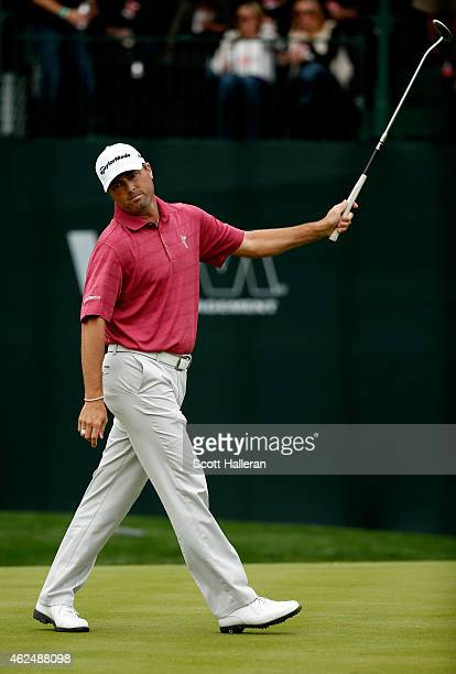 Ryan Palmer celebrates after sinking a birdie putt on the 16th green during the first round of the Waste Management Phoenix Open at TPC Scottsdale on...
