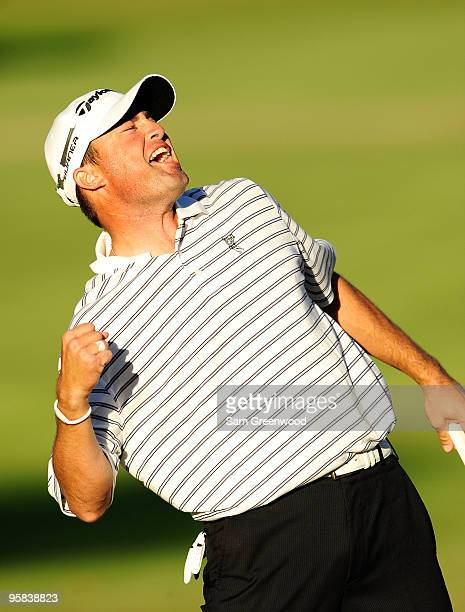 Ryan Palmer celebrates after winning the Sony Open at Waialae Country Club on January 17 2010 in Honolulu Hawaii