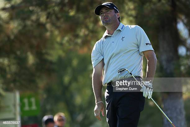 Ryan Palmer hits a tee shot at the eleventh hole of La Quinta Country Club Course during the second round of the Humana Challenge in partnership with...