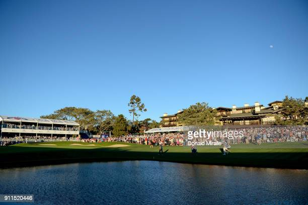 Ryan Palmer Jason Day of Australia and Alex Noren of Sweden walk up the fairway during the first playoff on the 18th hole during the final round of...
