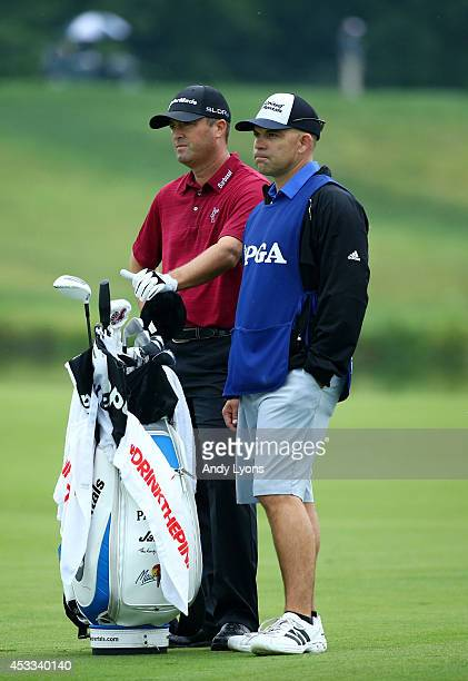 Ryan Palmer of the United States and caddie James Edmondson wait on the seventh hole fairway during the second round of the 96th PGA Championship at...