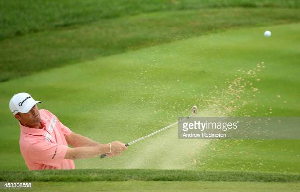 Ryan Palmer of the United States hits a shot from a bunker on the seventh hole during the first round of the 96th PGA Championship at Valhalla Golf...