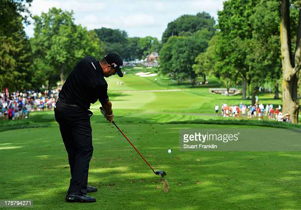 Ryan Palmer of the United States hits his tee shot on the 13th hole during the first round of the 95th PGA Championship on August 8 2013 in Rochester...