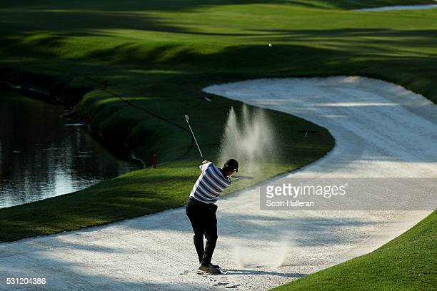 Ryan Palmer of the United States plays a shot from a bunker on the fifth hole during the second round of THE PLAYERS Championship at the Stadium...
