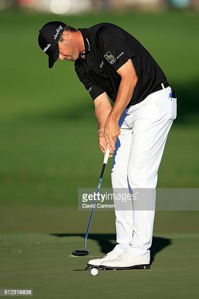 Ryan Palmer of the United States putts on the fourth green during the first round of the Honda Classic at PGA National Resort Spa Champions Course on...