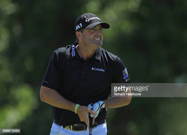 Ryan Palmer of the United States reacts after his shot from the fourth tee during the second round of the 2017 US Open at Erin Hills on June 16 2017...