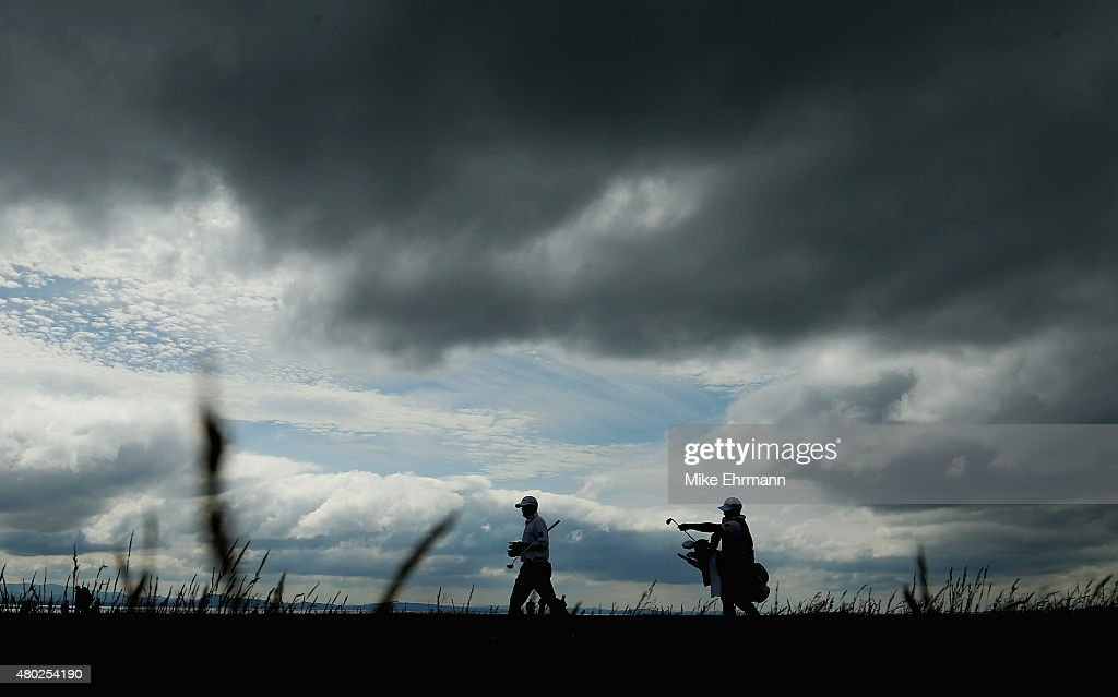 Ryan Palmer of the United States walks with his caddie on the 13th hole during the second round of the Aberdeen Asset Management Scottish Open at Gullane Golf Club on July 10, 2015 in Gullane, East Lothian, Scotland.