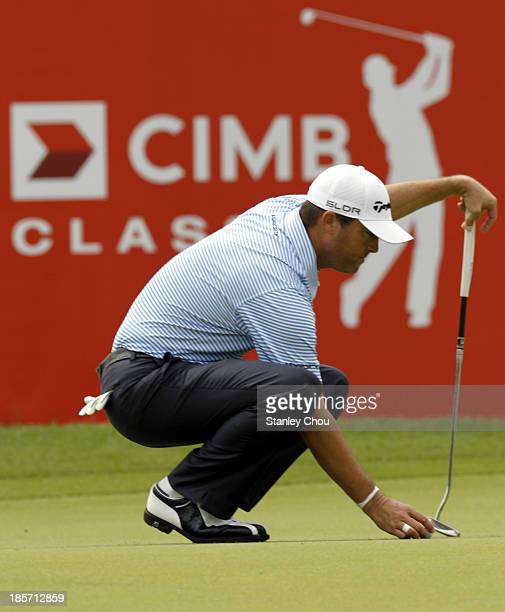 Ryan Palmer of USA prepares to putt on the 18th hole during round one of the CIMB Classic at Kuala Lumpur Golf Country Club on October 24 2013 in...