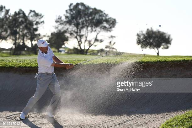 Ryan Palmer plays a shot from a bunker on the 14th hole during the final round of the Farmers Insurance Open at Torrey Pines South on January 28 2018...