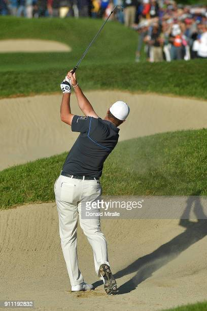 Ryan Palmer plays a shot from a bunker on the 17th hole during the third round of the Farmers Insurance Open at Torrey Pines South on January 27 2018...